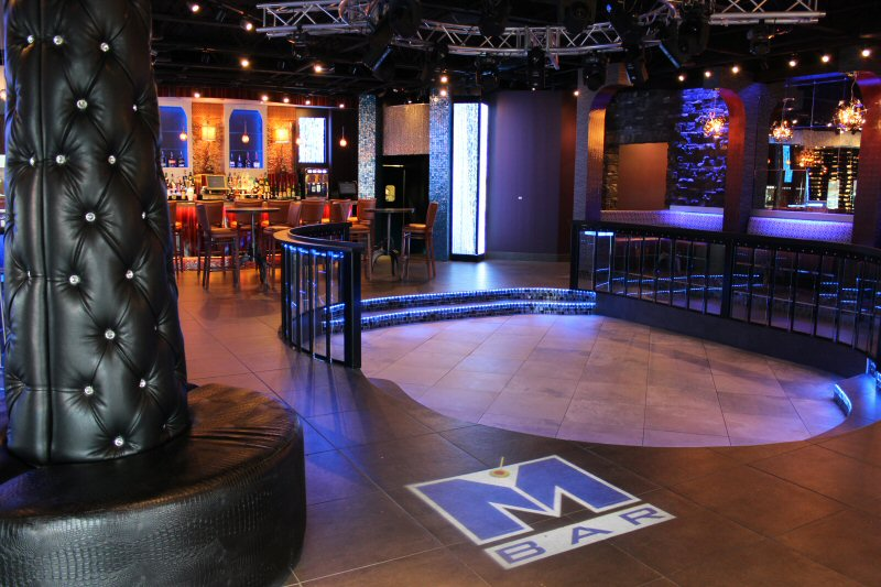 Empty dance floor with M Bar logo on floor