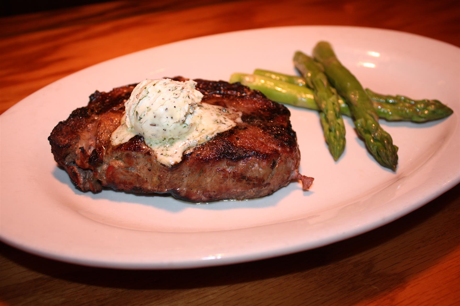 steak with a lob of butter and asparagus