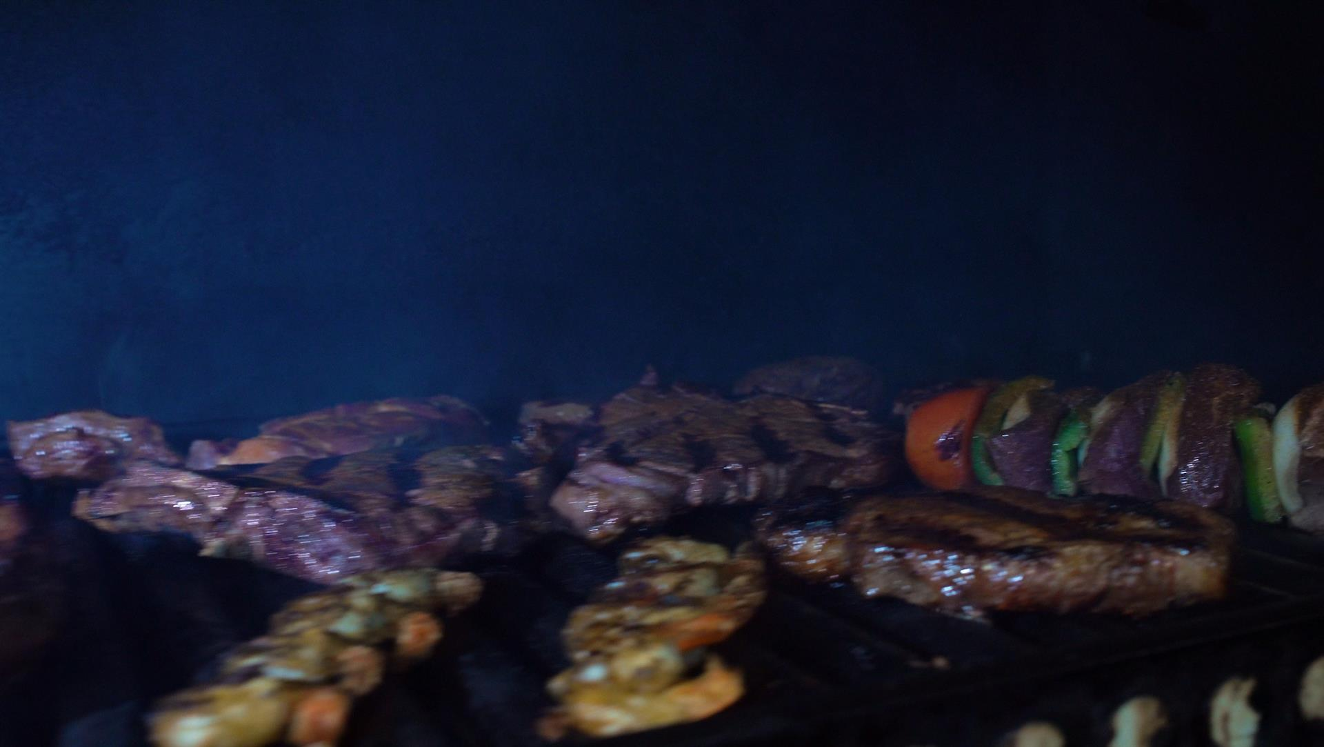 steaks on a grill with steak kabobs