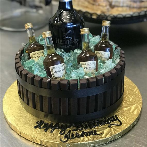 Kit-kat cake topped with alcohol