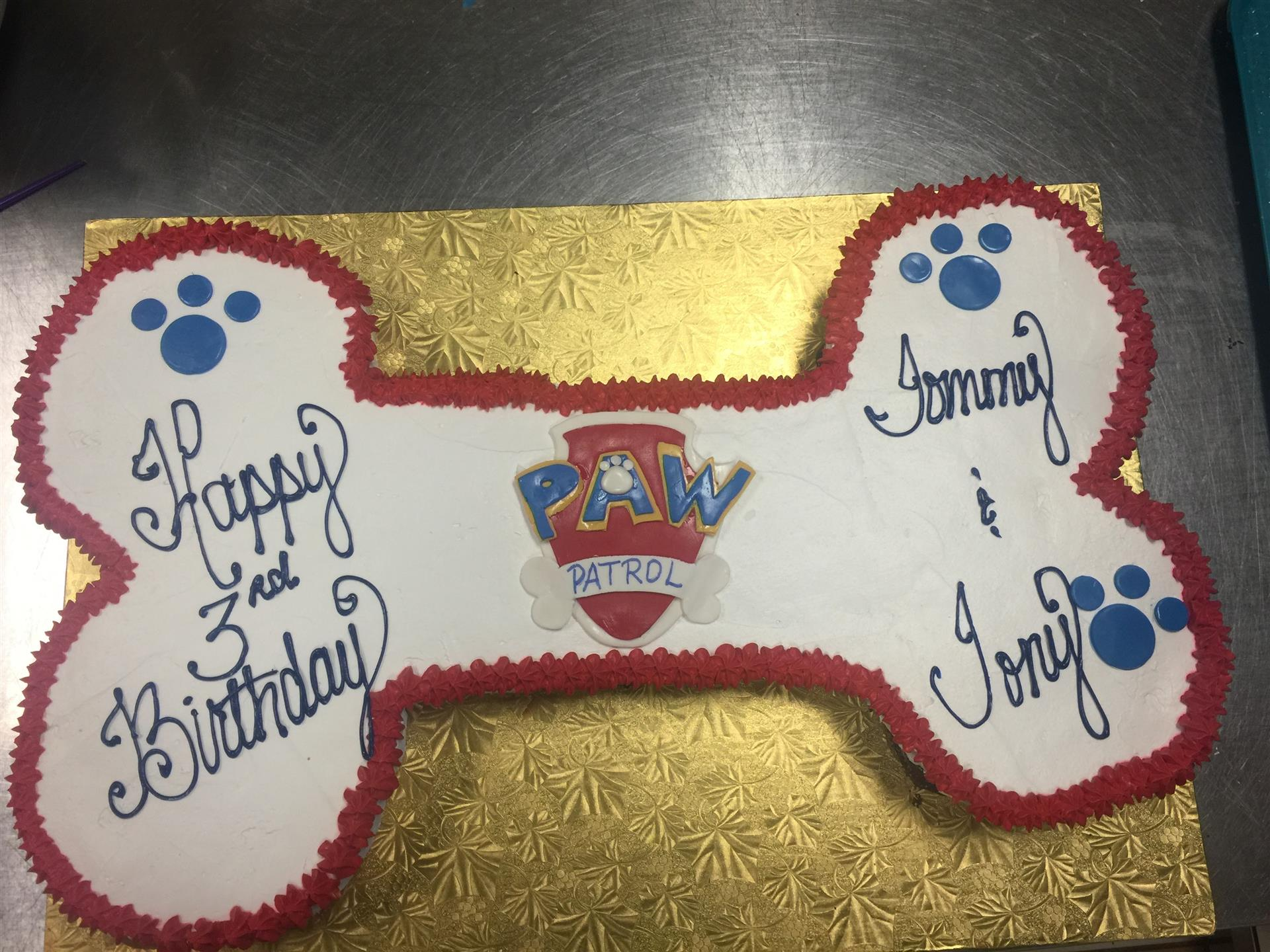a paw patrol cake shaped like a giant dog bone