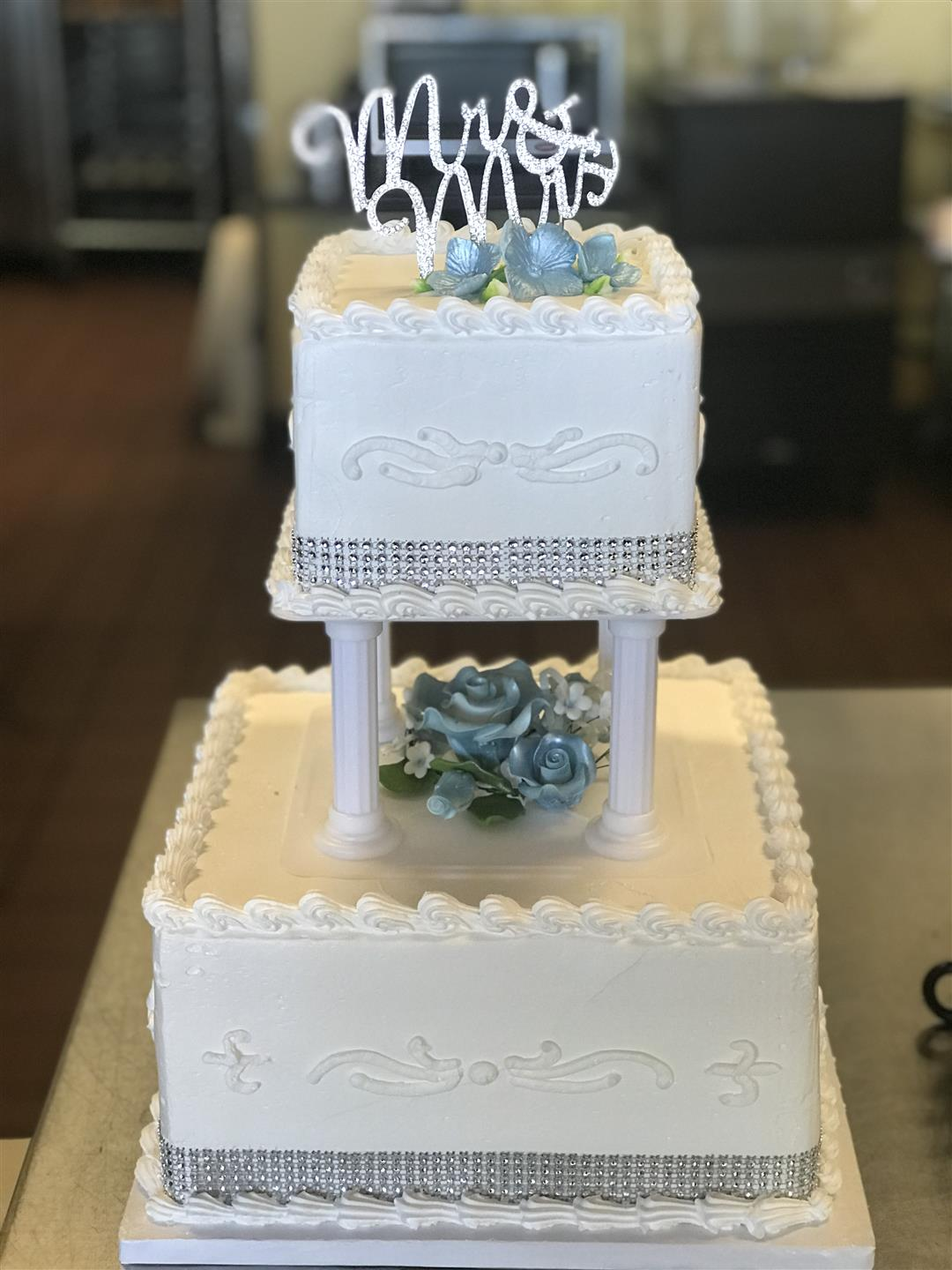 "2 tier wedding cake with a topper that says ""Always & Forever"""