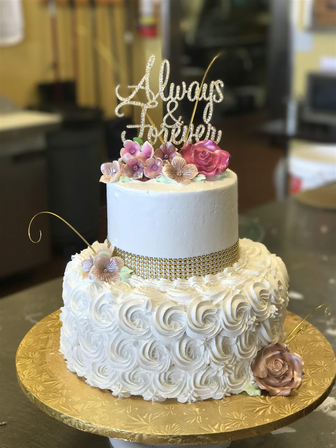 "a wedding cake with a topper that says ""Always & Forever"""