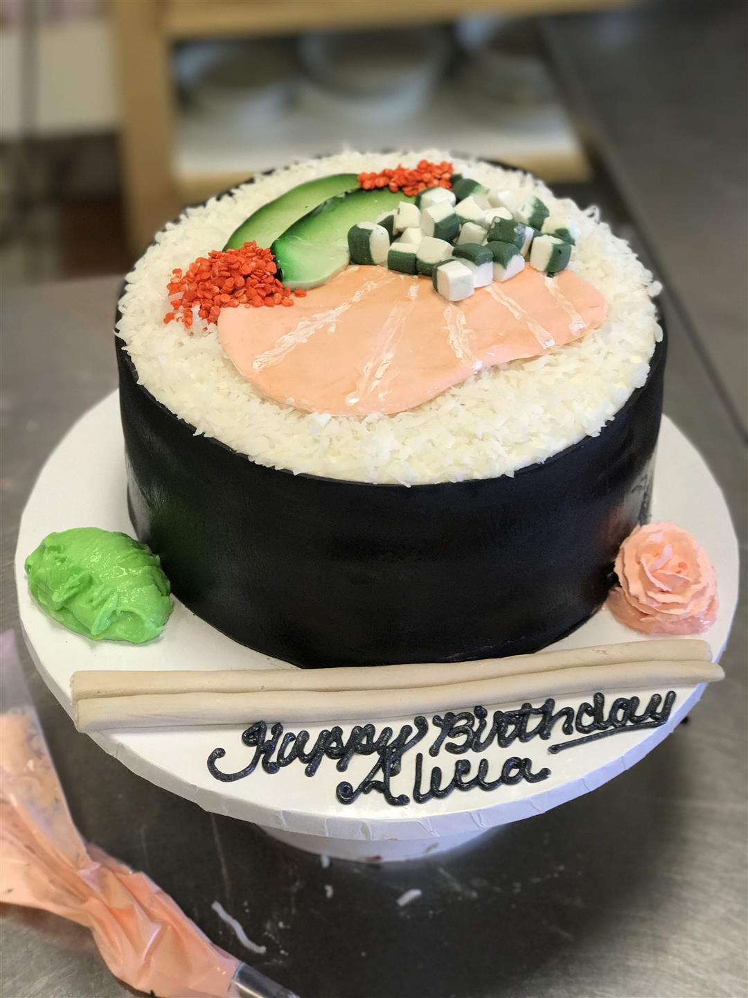 a cake shaped like a giant sushi roll