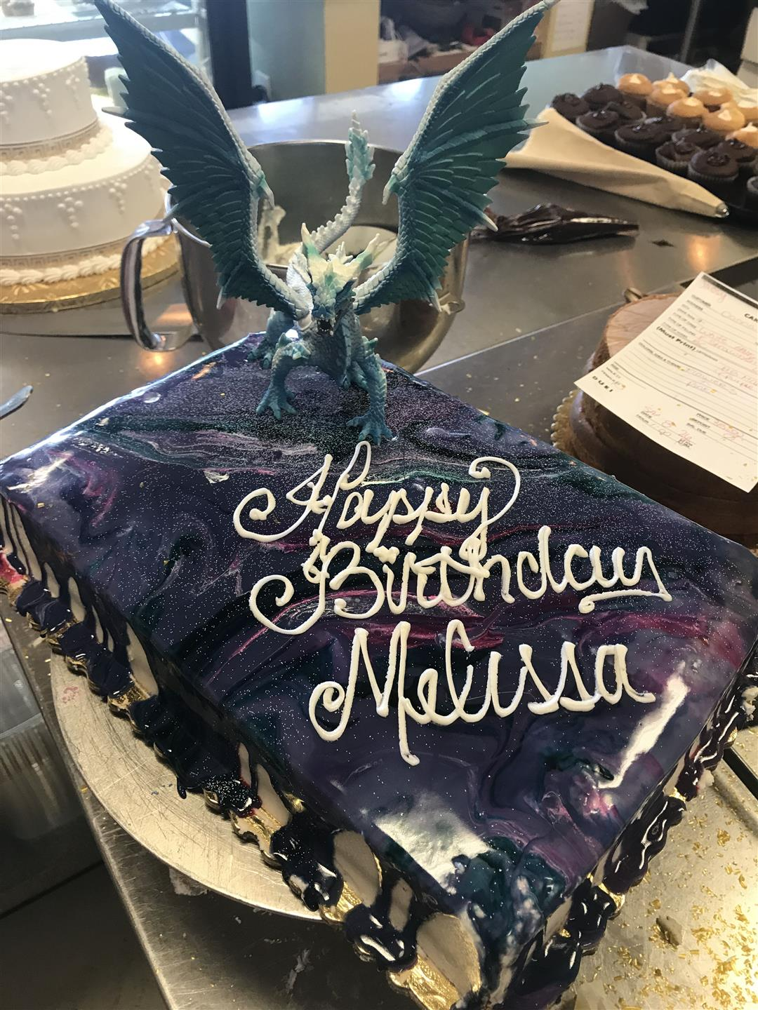 A cake with a dragon on top