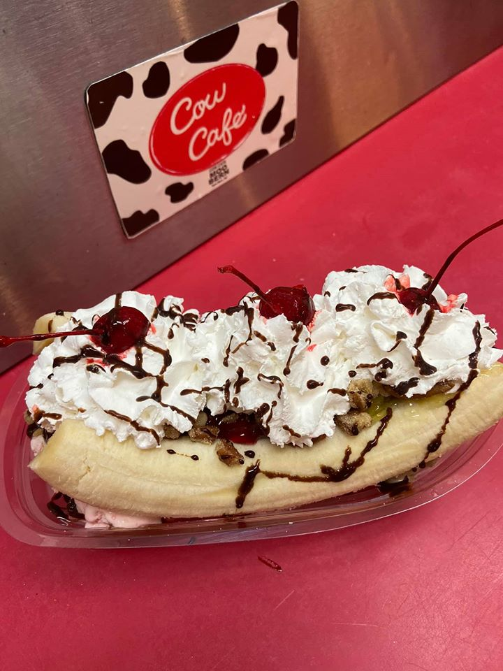 banana split ice cream topped with whipped cream and a cherry