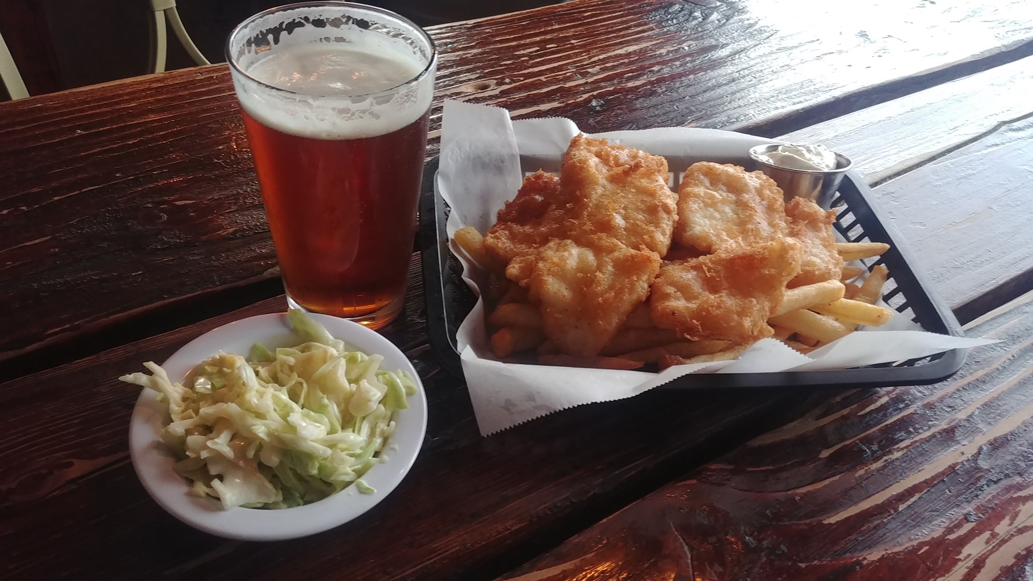Fried fish with coleslaw and pint of beer
