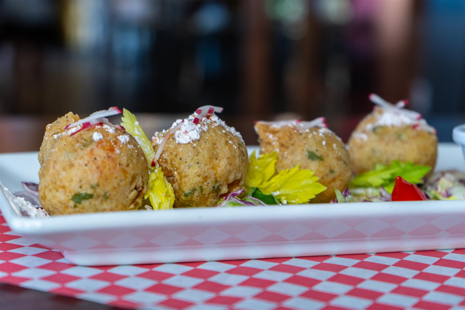 Crawfish Beignets. Seasoned crawfish croquettes deep-fried & sprinkled with cayenne powdered sugar served with Cajun rémoulade