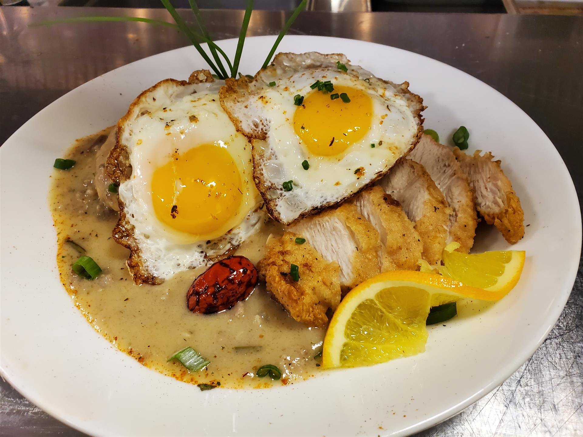 sunny side up eggs with breaded chicken