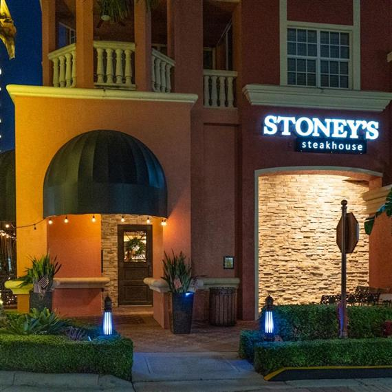 outside of Stoney's steakhouse with the logo sign lit up