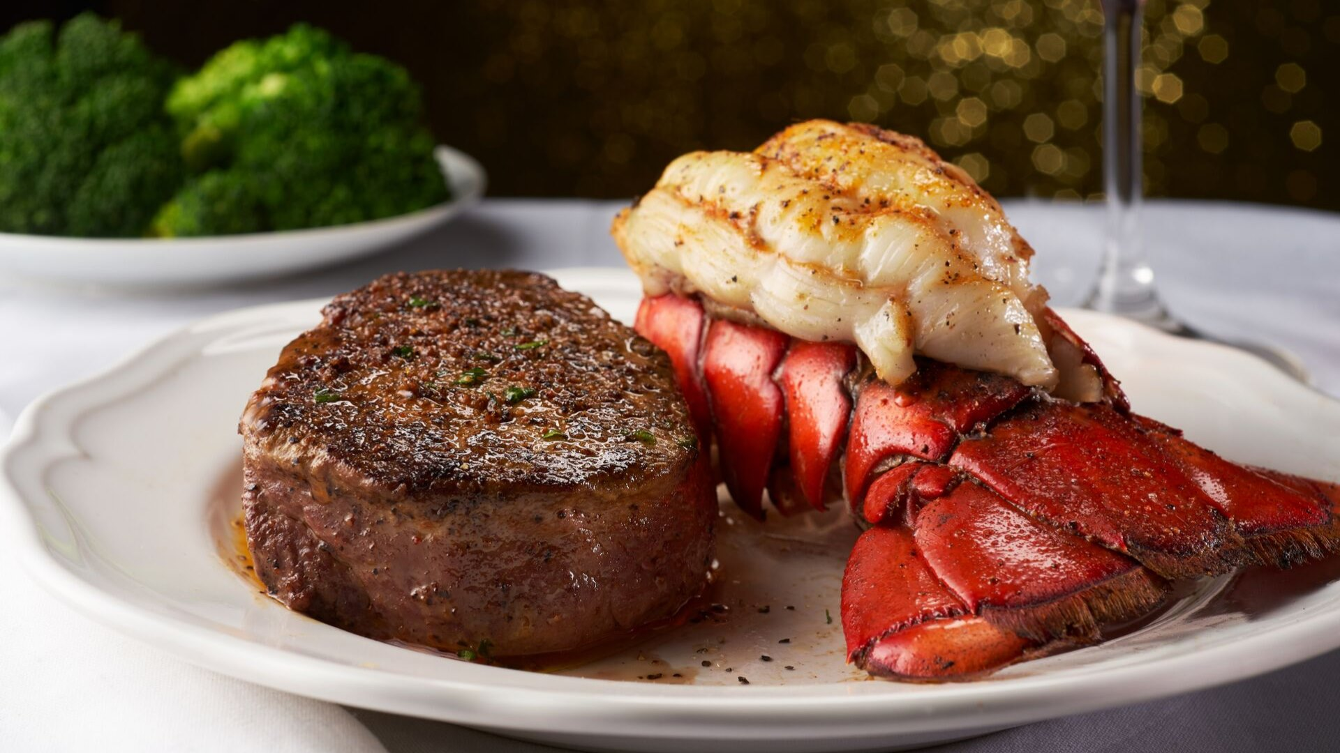 surf and turf: steak and lobster tail on a plate