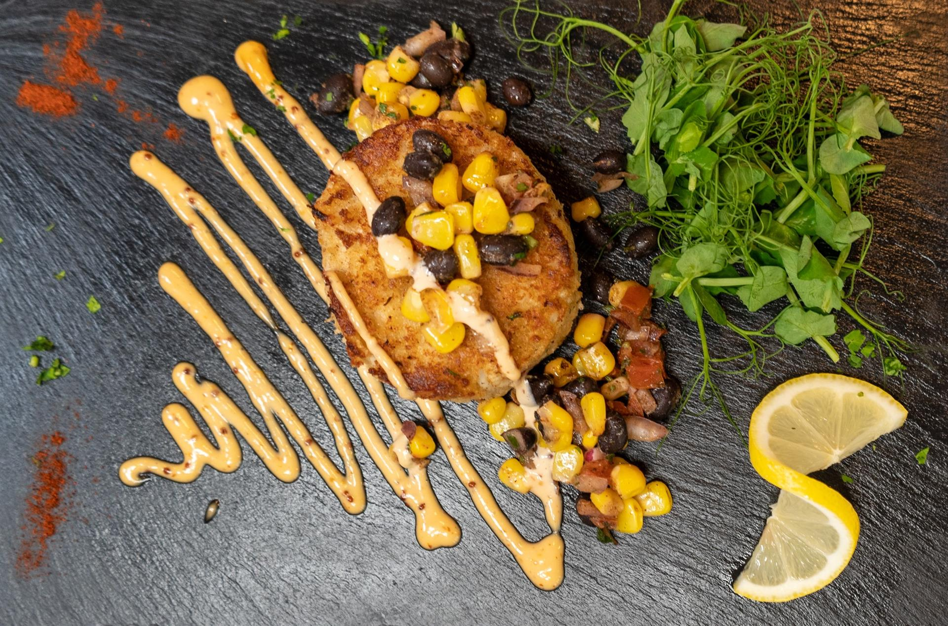 Jumbo Lump Crab Cake: Jumbo lump crab, roasted corn & black bean salsa with remoulade sauce