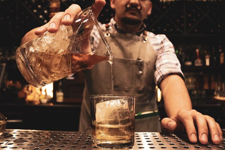 Bar Manager pours the perfect whiskey cocktail.