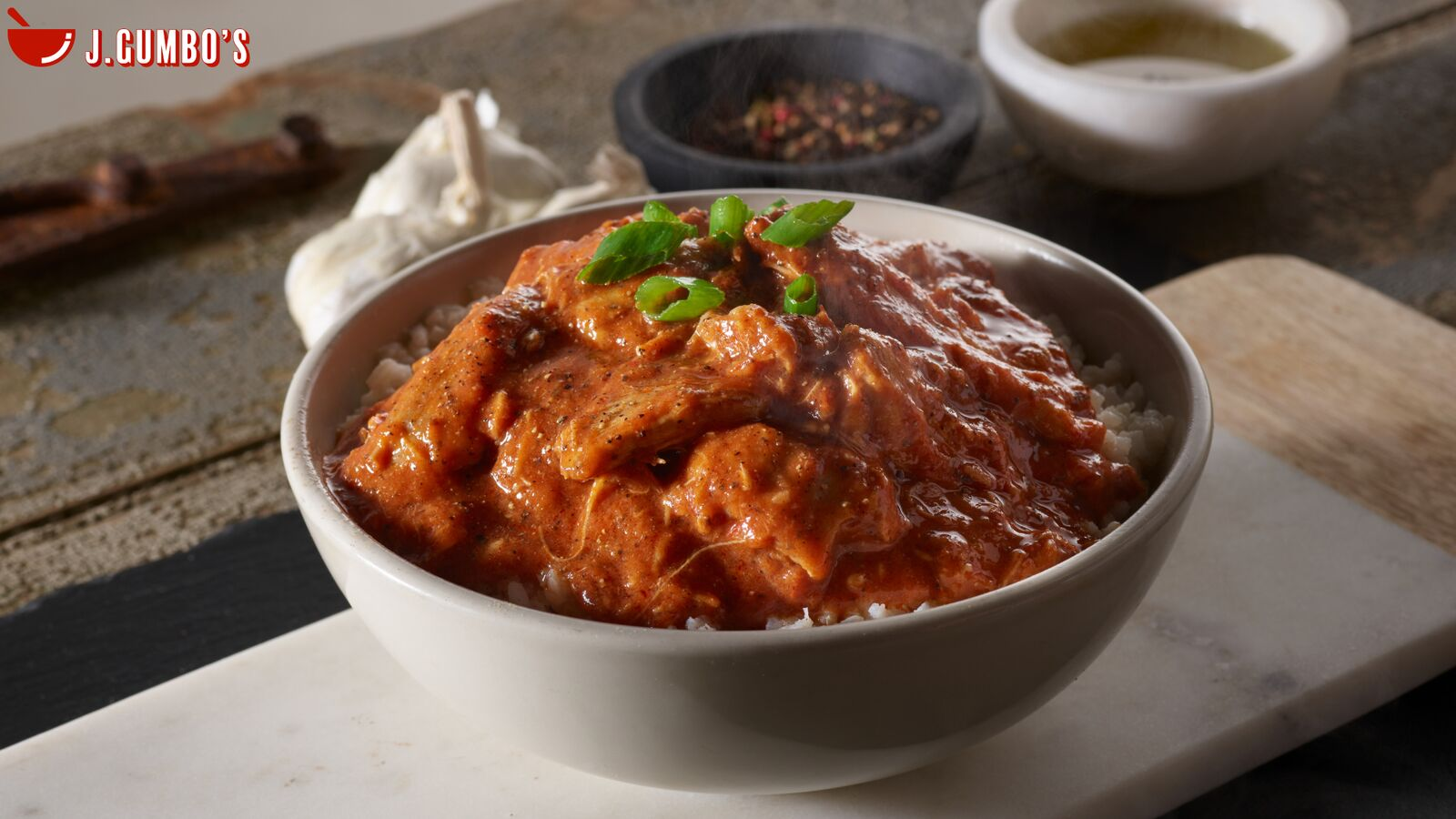 Voodoo Chicken: Slow-Cooked Chicken In Spicy Cajun Tomato Sauce With Garlic And Our Blend Of Voodoo Spices