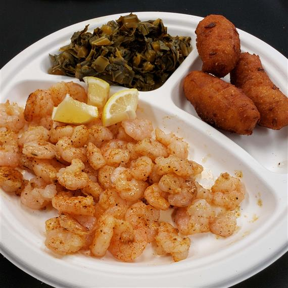 Popcorn shrimp with a side of fried fish and spinach