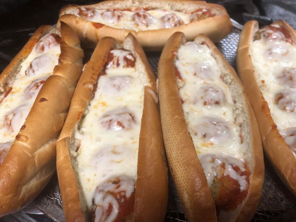 homemade meatball parmesan subs on a tray