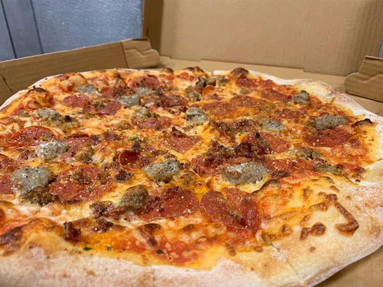 Meat Lovers Pizza. Pepperoni, sausage, bacon & meatballs