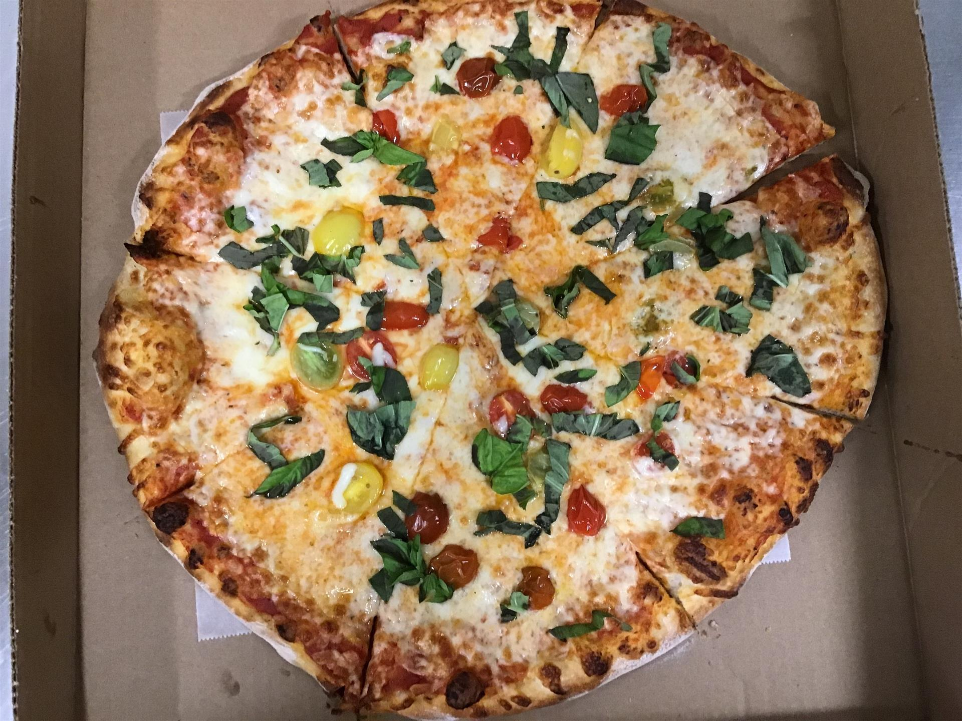 pizza with cheese and various vegetable toppings