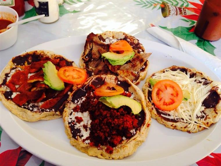 mini tortilla tostadas topped with various toppings