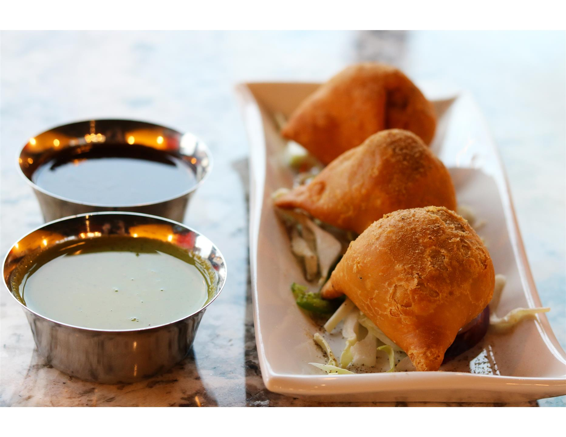 samosa appetizer with dipping sauces