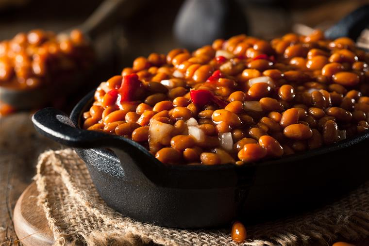 baked beans with diced peppers and onions in a skillet