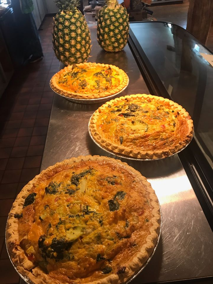 three quiche pies on a table