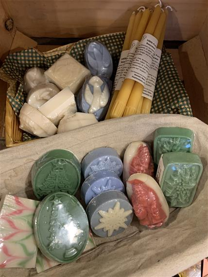 basket of handmade holiday soaps and candles