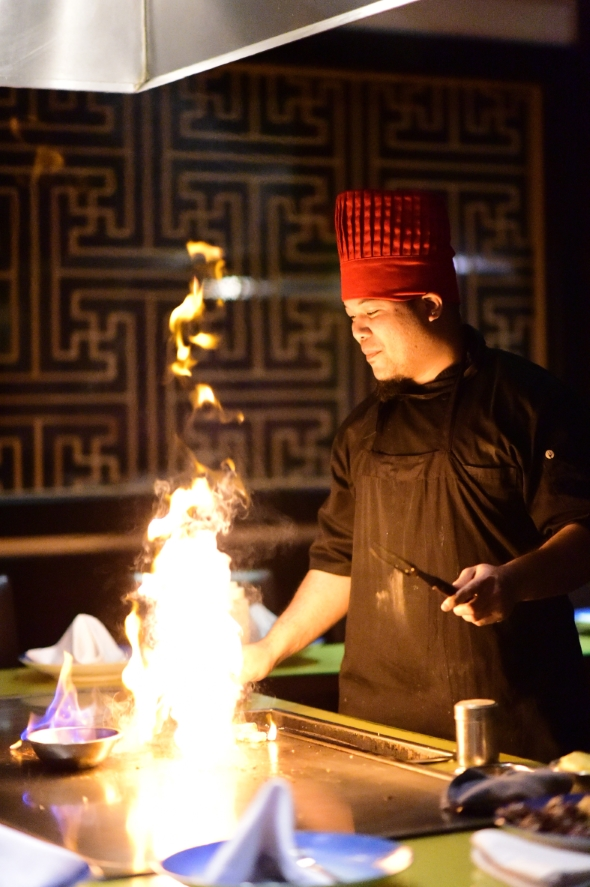 Hibachi chef cooking over large flame