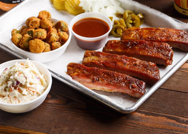 4 BBQ ribs with a sides of fried pickles, BBQ sauce, cole slaw, and spicy peppers.