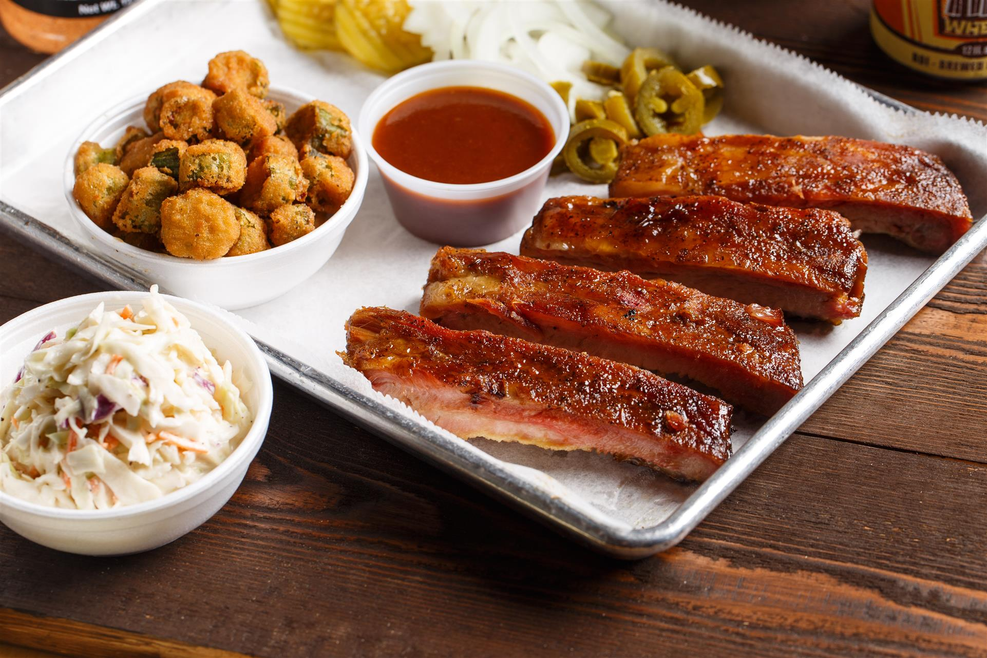 BBQ ribs with a side of fried pickles