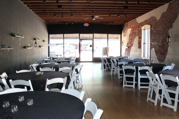 99 main catering room with multiple round tables and chairs