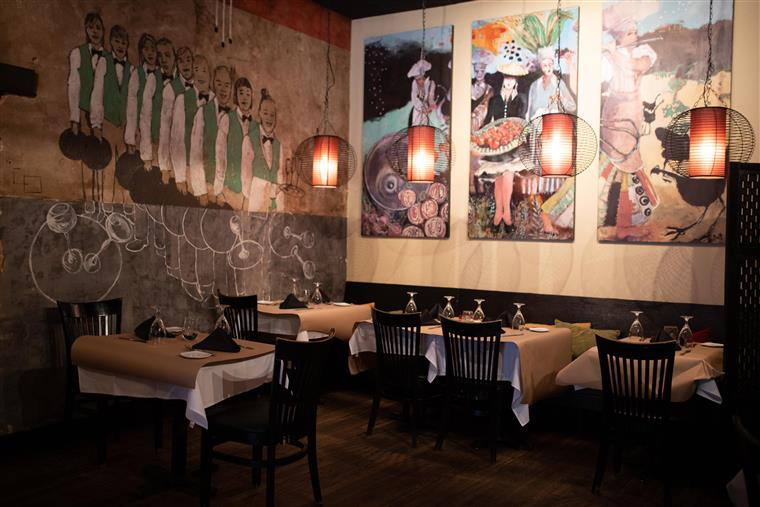 inside of the restaurant with chalk paintings on the walls