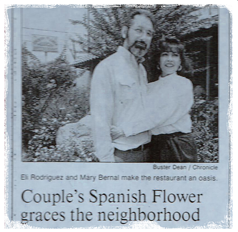 Newspaper clipping of the owners with the caption Couple's Spanish Flower graces the neighborhood. Eli Rodriquez and Mary Bermal make the restaurant an oasis.
