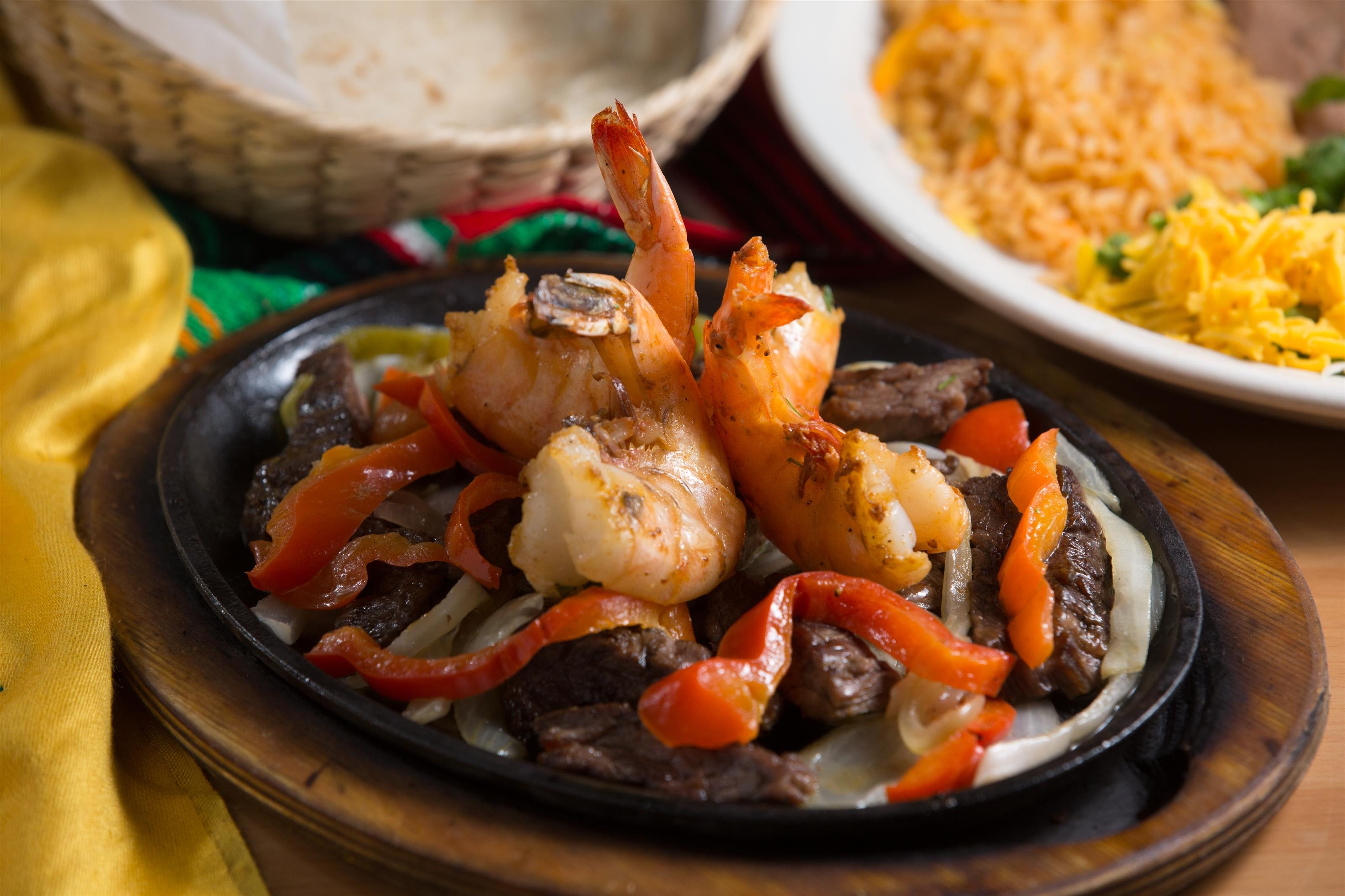 shrimp and steak fajitas with peppers and onions