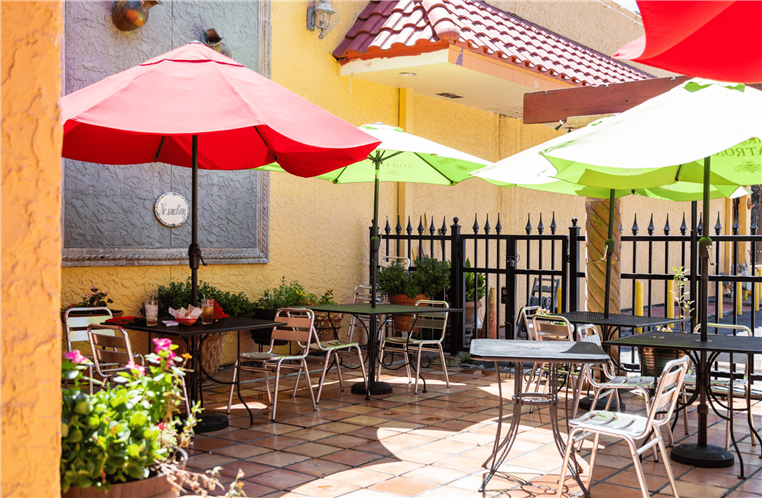 outside patio with tables, chairs and umbrellas