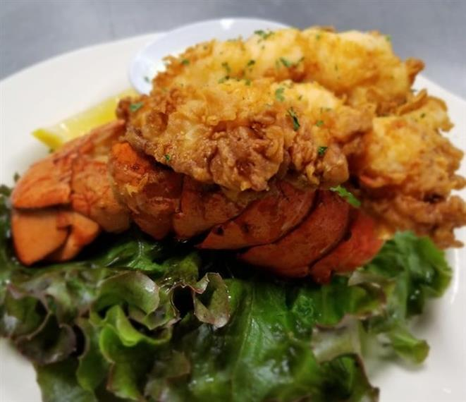 stuffed lobster tail served with field greens