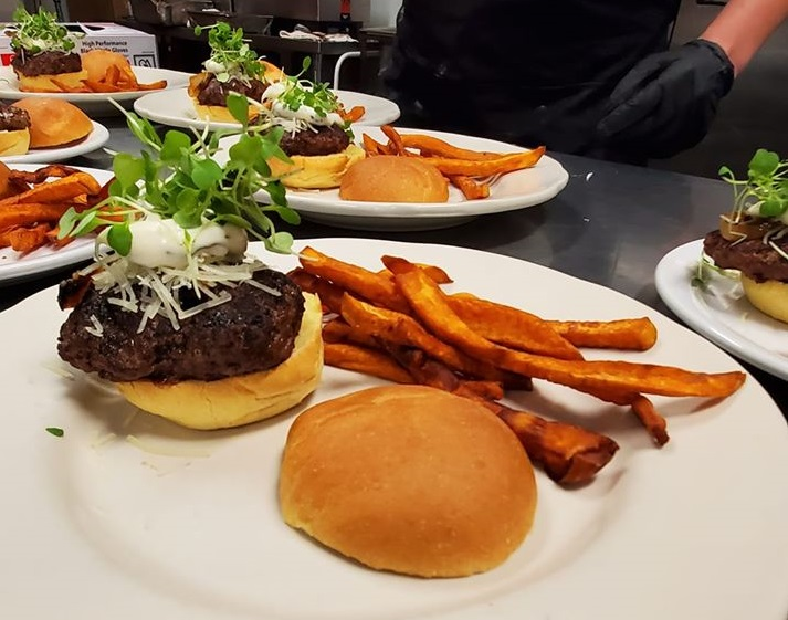 burgers with sweet potato fries on the side
