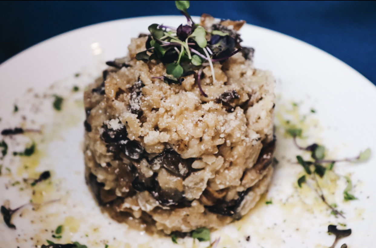 a tower of risotto topped with garnish