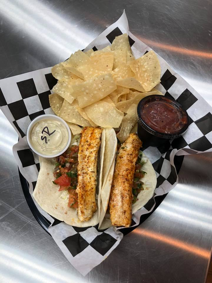 Fish Tacos with side of chips and sauces