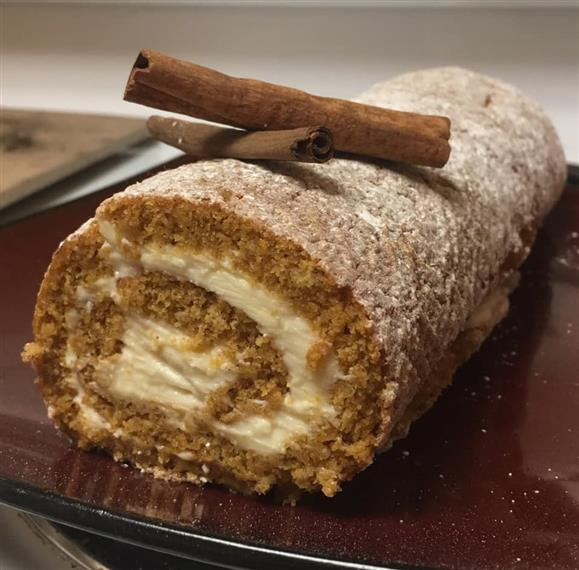 Pumpkin bread rolled with icing in the middle