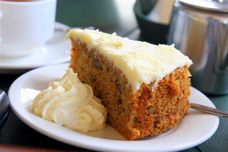 A slice of carrot cake, topped with icing