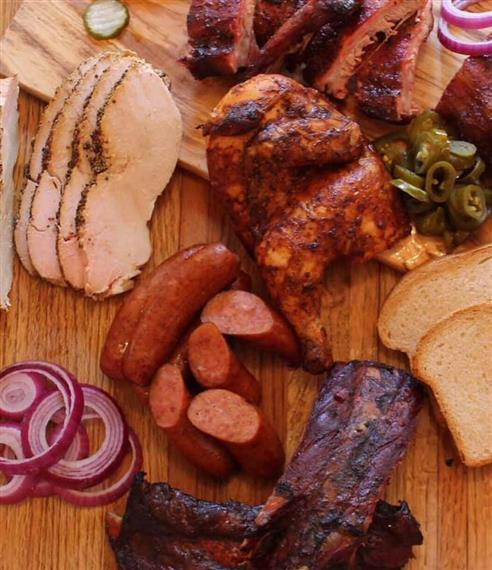 assorted meats on a wood table