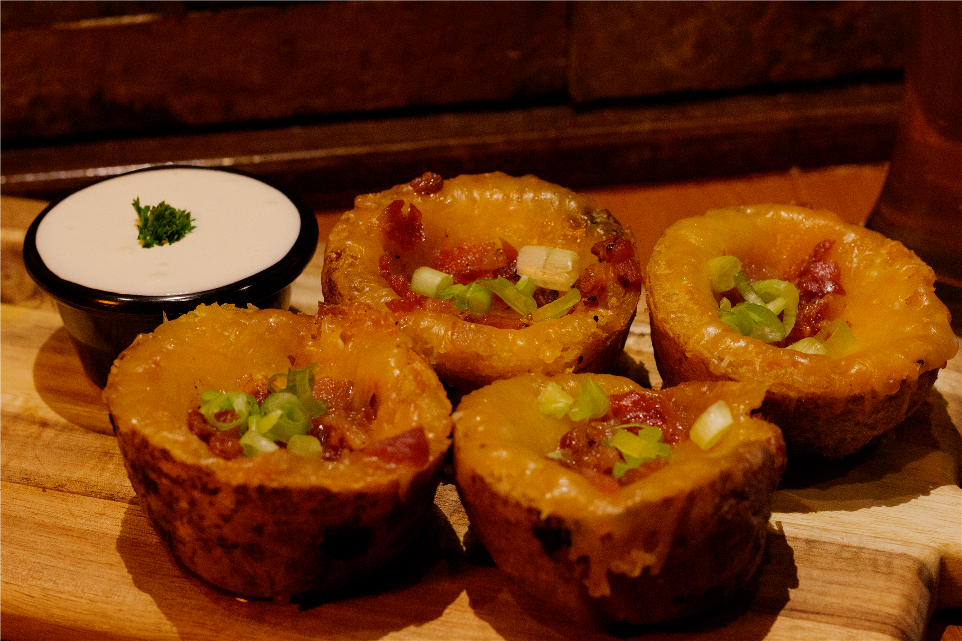 potato skins with bacon and melted cheese, with a side of sour cream