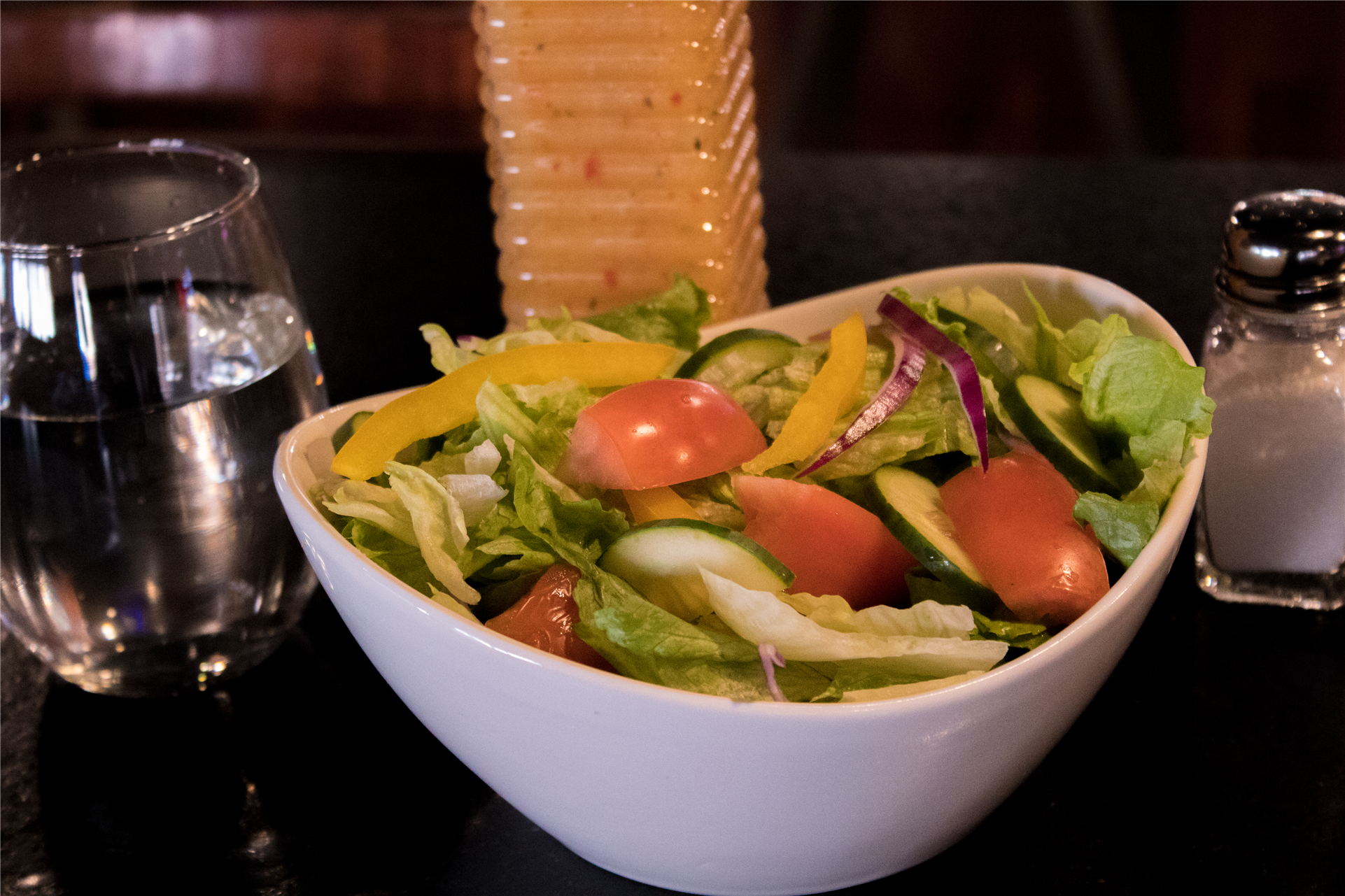 bowl of salad with a glass of water