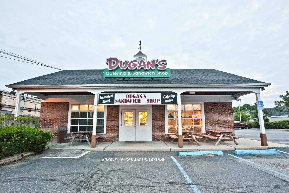 exterior view of dugans sandwich shop and parking lot