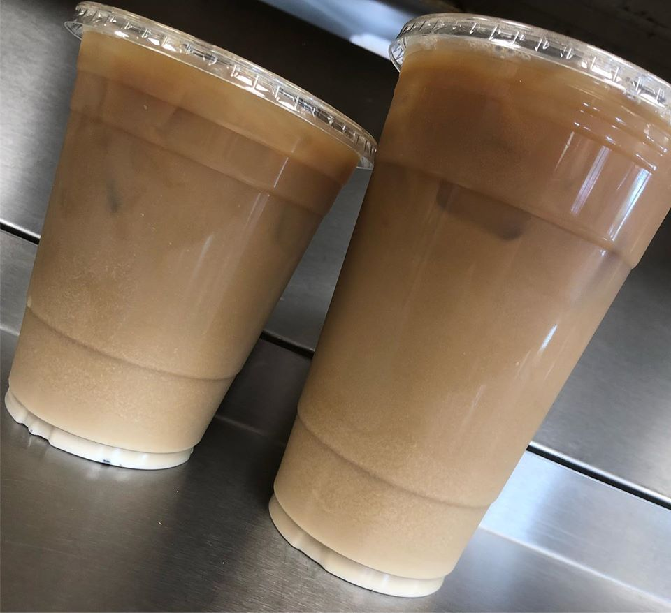 two iced coffees on a counter top