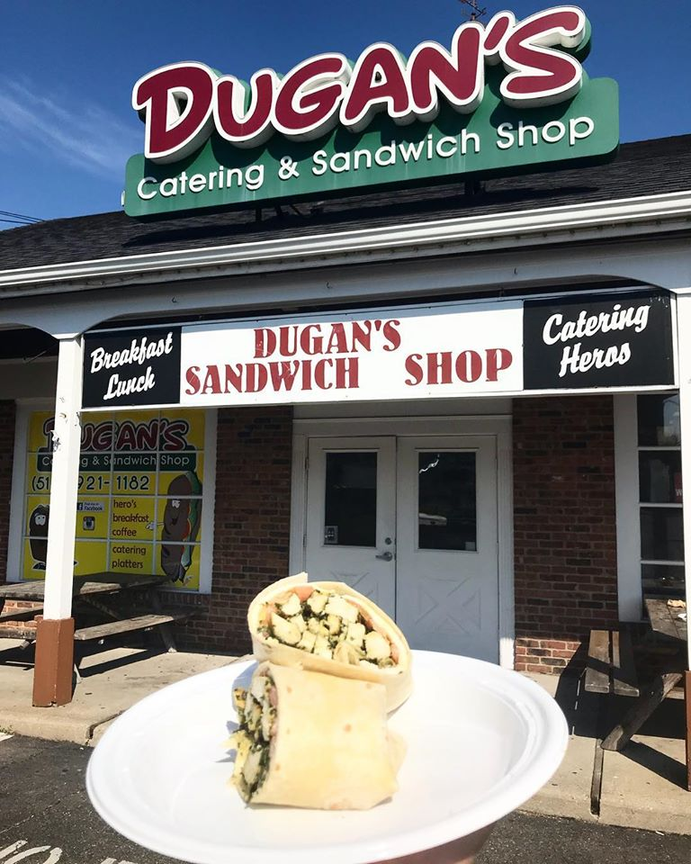 exterior view of dugans sandwich shop with a wrap on a plate
