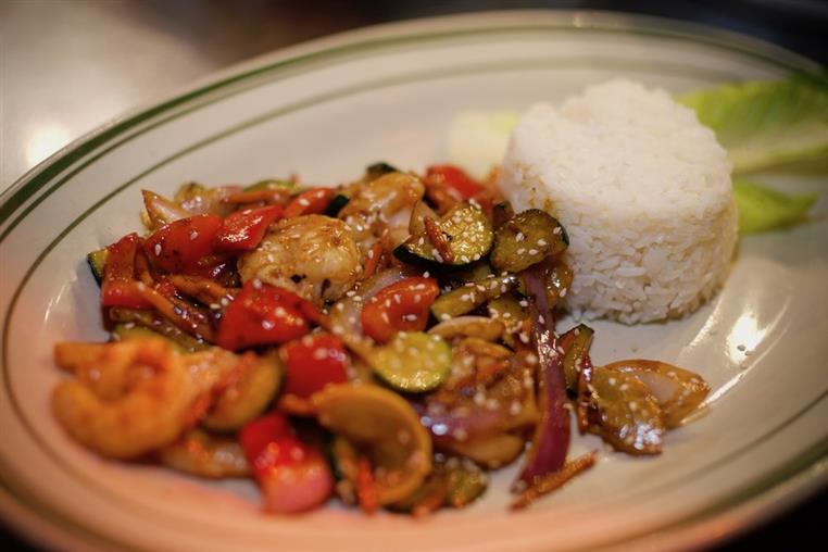 Grilled shrimp and vegetables with a side of rice