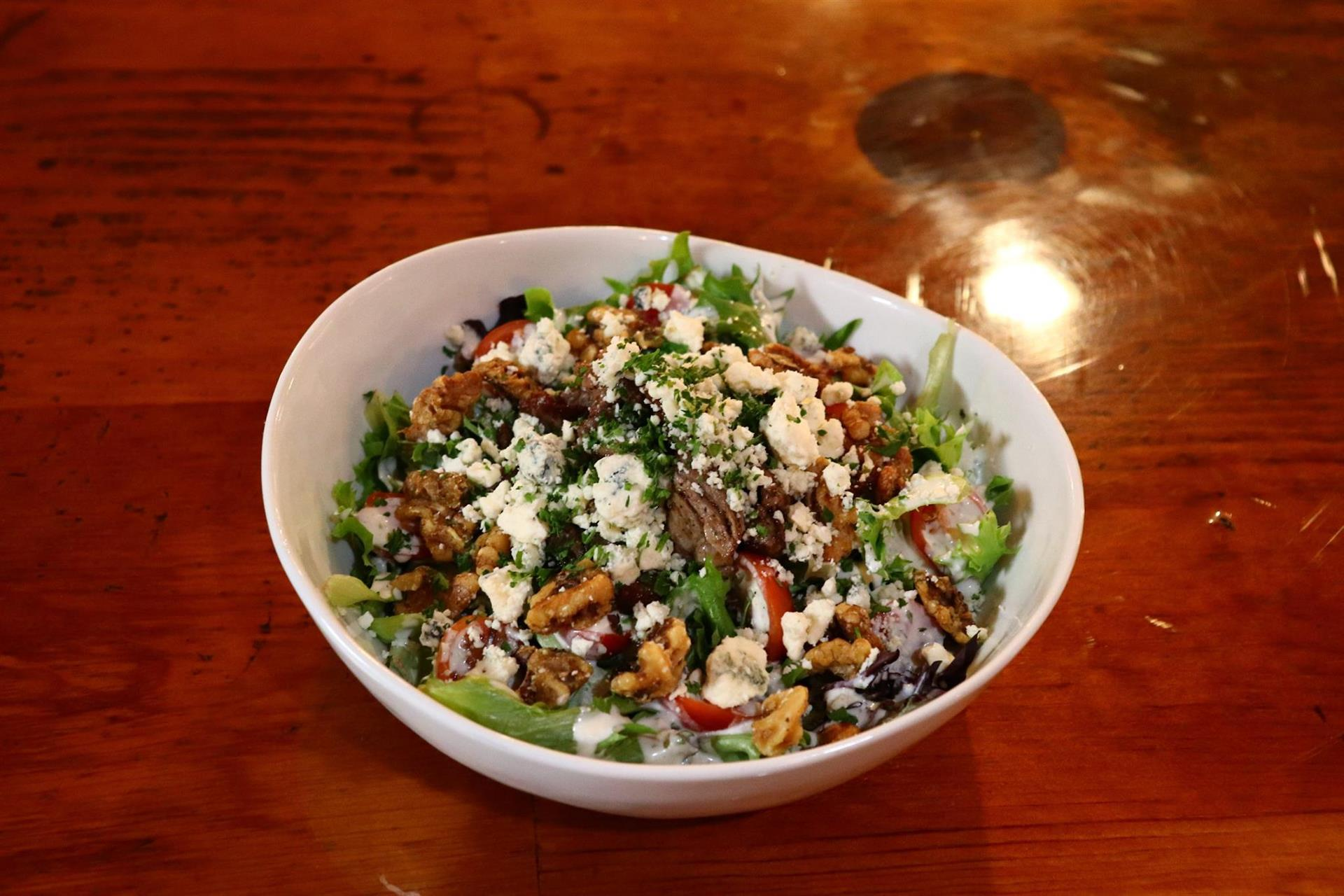Steak and Blue Cheese Salad: mixed greens, candied wallnut with blue cheese crumble and blue cheese dressing