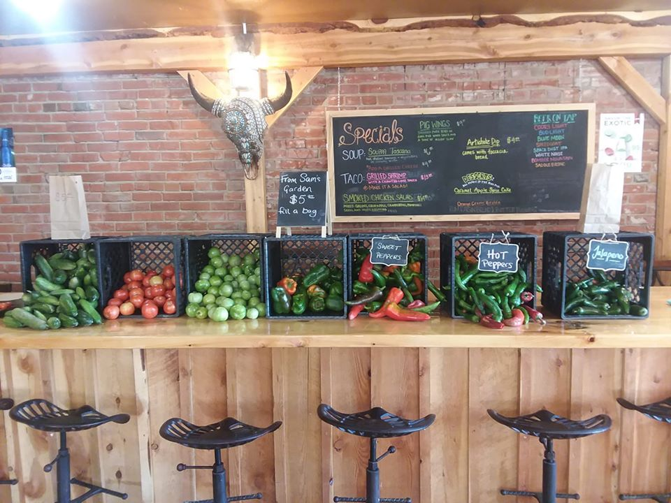 Boxes of vegetables on wooden table